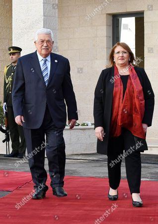 Palestinian President Mahmoud Abbas welcomes Malta's President Marie Louise Coleiro Preca during a reception ceremony