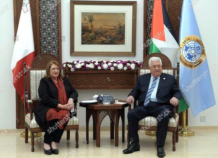 Palestinian President Mahmoud Abbas meets with Malta's President Marie Louise Coleiro Preca