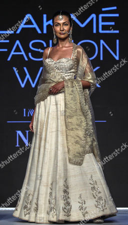 Models present creations by Indian designers Anita Dongre during the Lakme Fashion Week (LFW) Summer/Resort 2019 in Mumbai, India, 31 January 2019.