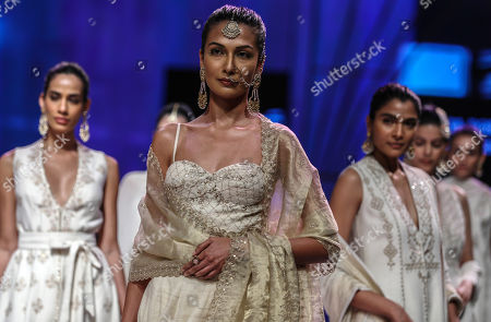 Stock Photo of Models present creations by Indian designers Anita Dongre during the Lakme Fashion Week (LFW) Summer/Resort 2019 in Mumbai, India, 31 January 2019.