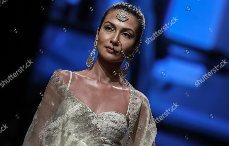 A model presents a creation by Indian designers Anita Dongre during the Lakme Fashion Week (LFW) Summer/Resort 2019 in Mumbai, India, 31 January 2019.