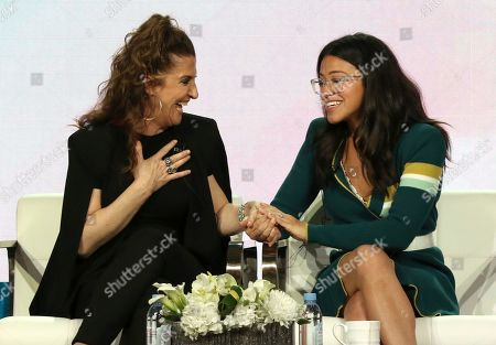 """Jennie Snyder Urman, Gina Rodriguez. Executive producer Jennie Snyder Urman, left, and Gina Rodriguez speak to each other in the A Final Farewell to """"Jane the Virgin"""" panel during the Showtime TCA Winter Press Tour, in Pasadena, Calif"""