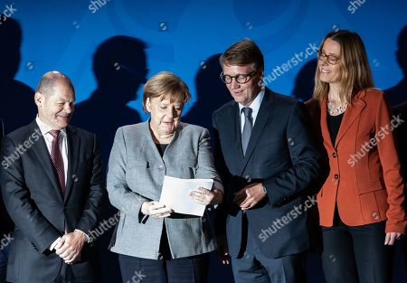 Stock Image of (L-R) Minister of Finance Olaf Scholz, German Chancellor Angela Merkel and Chairpersons of the Coal Commission Ronald Pofalla and Stanislaw Tillich, during the handover of the final report of the Coal Commission 'Growth, structural change and employment' to the Federal Government, at the Chancellery in Berlin, Germany, 31 January 2019.