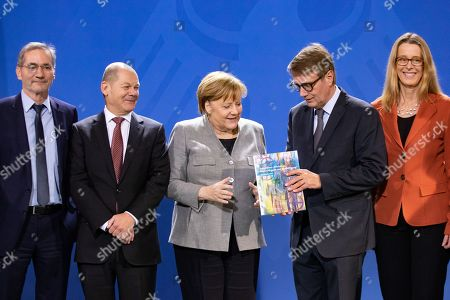 Stock Photo of (L-R) Mathias Platzeck, Minister of Finance Olaf Scholz, German Chancellor Angela Merkel, Ronald Pofalla and Stanislaw Tillich, during the handover of the final report of the Coal Commission 'Growth, structural change and employment' to the Federal Government, at the Chancellery in Berlin, Germany, 31 January 2019.