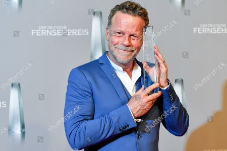 German TV journalist Jenke von Wilmsdorff poses with his 'Best Infotainment' award during the prize-giving ceremony of the 20th German Television Award in Duesseldorf, Germany 31 January 2019. The Deutscher Fernsehpreis is awarded for television programming by four German TV channels annually.
