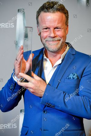 Stock Image of German TV journalist Jenke von Wilmsdorff poses with his 'Best Infotainment' award during the prize-giving ceremony of the 20th German Television Award in Duesseldorf, Germany 31 January 2019. The Deutscher Fernsehpreis is awarded for television programming by four German TV channels annually.