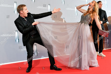 German actor and TV presenter Jan Hahn (L) and Angela Finger-Erben (R) arrive for the prize-giving ceremony of the 20th German Television Award in Duesseldorf, Germany 31 January 2019. The Deutscher Fernsehpreis is awarded for television programming by four German TV channels annually.
