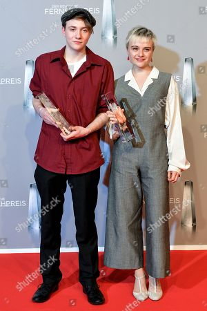 Lena Urzendowsky (R) and actor Michelangelo Fortuzzi (L) pose with their sponsorship awards during the prize-giving ceremony of the 20th German Television Award in Duesseldorf, Germany 31 January 2019. The Deutscher Fernsehpreis is awarded for television programming by four German TV channels annually.