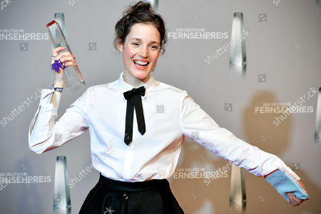 Luxembourgish actress Vicky Krieps poses with her 'Best Actress' award for 'Das Boot' (The Boat) during the prize-giving ceremony of the 20th German Television Award in Duesseldorf, Germany 31 January 2019. The Deutscher Fernsehpreis is awarded for television programming by four German TV channels annually.