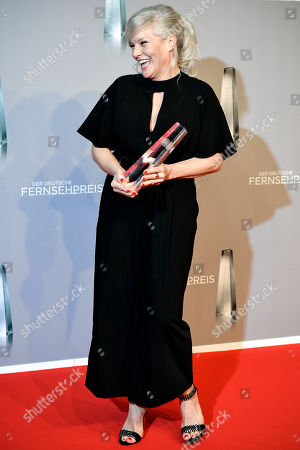 Stock Image of German singer and TV host Ina Mueller poses with her 'Best Entertainment late Night' award during the prize-giving ceremony of the 20th German Television Award in Duesseldorf, Germany 31 January 2019. The Deutscher Fernsehpreis is awarded for television programming by four German TV channels annually.