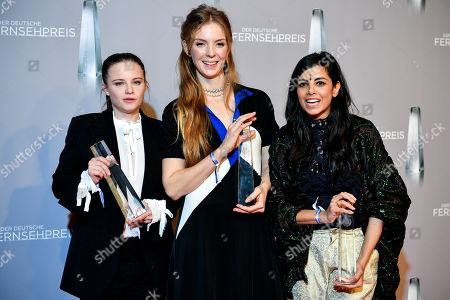 Stock Photo of Jasna Fritzi Bauer, Pheline Roggan and Collien Ulmen-Fernandes pose with their awards for 'Best Comedy-Series' for 'Jerks' during the prize-giving ceremony of the 20th German Television Award in Duesseldorf, Germany 31 January 2019. The Deutscher Fernsehpreis is awarded for television programming by four German TV channels annually.