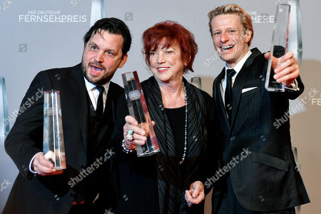 Stock Image of Sascha Alexander Gersak, film producer Regina Ziegler and Alexander Scheer pose with their awards for 'Best limited series - Gladbeck' during the prize-giving ceremony of the 20th German Television Award in Duesseldorf, Germany 31 January 2019. The Deutscher Fernsehpreis is awarded for television programming by four German TV channels annually.
