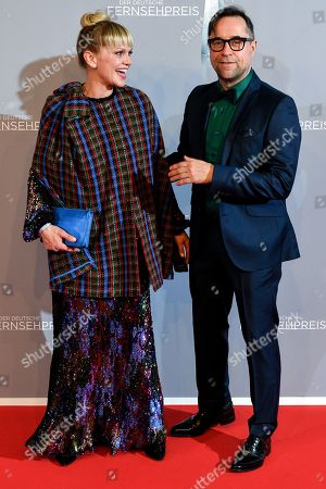 Stock Photo of Anna Loos (L) and husband actor Jan Josef Liefers (R) arrive for the prize-giving ceremony of the 20th German Television Award in Duesseldorf, Germany 31 January 2019. The Deutscher Fernsehpreis is awarded for television programming by four German TV channels annually.