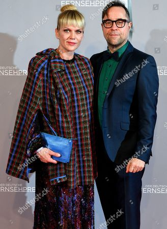Anna Loos (L) and husband actor Jan Josef Liefers (R) arrive for the prize-giving ceremony of the 20th German Television Award in Duesseldorf, Germany 31 January 2019. The Deutscher Fernsehpreis is awarded for television programming by four German TV channels annually.