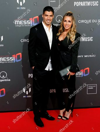 Uruguayan forward Luis Suarez (L) and his wife Sofia Balbi (R) pose for the photographers on the red carpet, during the presentation of Cirque du Soleil in partnership with Argentinian soccer player Leo Messi at Camp Nou in Barcelona, Catalonia, Spain, 31 January 2019. Leo Messi, Cirque du Soleil Entertainment Group and PopArt Music announce their partnership for the creation of a brand-new show to be launched in 2019, in association with Sony Music.
