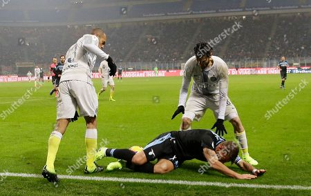 Lazio's Ciro Immobile, center, challenges for the ball with Inter Milan's Joao Miranda, left and Inter Milan's Antonio Candreva during an Italian Cup quarterfinal soccer match between Inter Milan and Lazio at the San Siro stadium, in Milan, Italy