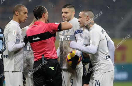 Referee Rosario Abisso, second from left, talks with Inter Milan's Radja Nainggolan, right, Inter Milan's Joao Miranda, left, and Inter Milan's Mauro Icardi during an Italian Cup quarterfinal soccer match between Inter Milan and Lazio at the San Siro stadium, in Milan, Italy