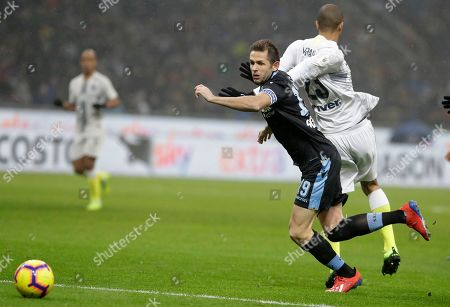 Inter Milan's Joao Miranda, right, challenges for the ball with Lazio's Senad Lulic during an Italian Cup quarterfinal soccer match between Inter Milan and Lazio at the San Siro stadium, in Milan, Italy