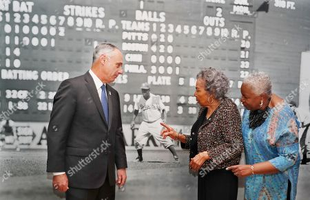 """Rob Manfred, Rachel Robinson, Sharon Robinson. Major League Baseball Commissioner Rob Manfred, left, Rachel Robinson, center, widow of the late Jackie Robinson, and Sharon Robinson, the couple's daughter, inspect a mural-sized photograph of Jackie Robinson in uniform displayed at the Museum of the City of New York, in New York. The photo is part of """"In the Dugout with Jackie Robinson,"""" an exhibition celebrating Robinson's 100th birthday, mounted in collaboration with The Jackie Robinson Foundation. The exhibit features 30 photographs originally shot for Look Magazine (most never published) and rare Robinson family home movies plus memorabilia related to Robinson's career"""