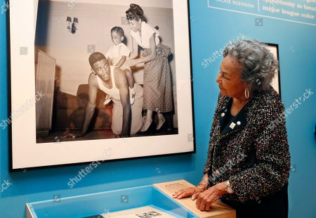 """Stock Image of Rachel Robinson, widow of the late Jackie Robinson, looks at a photograph of her husband, herself and their son Jackie Jr., displayed at the Museum of the City of New York, in New York part of an exhibition celebrating Robinson's 100th birthday. """"In the Dugout with Jackie Robinson,"""" mounted in collaboration with The Jackie Robinson Foundation, features 30 photographs originally shot for Look Magazine (most never published), rare home movies of the Robinson family plus memorabilia related to Robinson's career"""