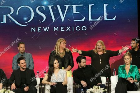 "Stock Image of Michael Trevino, Jeanine Mason, Nathan Parsons, Lily Cowles, Christopher Hollier, Carina Adly MacKenzie, Julie Plec, Karan Oberoi. Michael Trevino, from front row left, Jeanine Mason, Nathan Parsons, Lily Cowles, and from back row left, executive producers Christopher Hollier, Carina Adly MacKenzie and Julie Plec and Karan Oberoi participate in the ""Roswell, New Mexico"" panel during the CW TCA Winter Press Tour, in Pasadena, Calif"