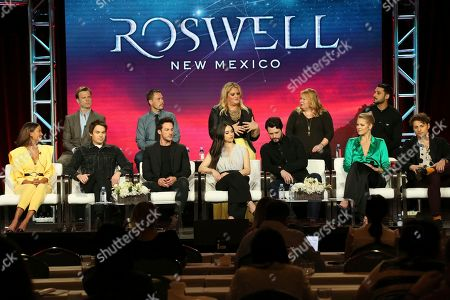 "Stock Photo of Heather Hemmens, Tyler Blackburn, Michael Trevino, Jeanine Mason, Nathan Parsons, Lily Cowles, Michael Vlamis, Trevor St. John, Christopher Hollier, Carina Adly MacKenzie, Julie Plec, Karan Oberoi. Heather Hemmens, from front row left, Tyler Blackburn, Michael Trevino, Jeanine Mason, Nathan Parsons, Lily Cowles, Michael Vlamis and from back row left, Trevor St. John, executive producers Christopher Hollier, Carina Adly MacKenzie and Julie Plec and Karan Oberoi participate in the ""Roswell, New Mexico"" panel during the CW TCA Winter Press Tour, in Pasadena, Calif"