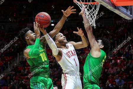 Utah guard Charles Jones Jr (1) is fouled while shooting the ball by Oregon guard Victor Bailey Jr. (10) during the second half of an NCAA college basketball game, in Salt Lake City. Oregon won 78-72