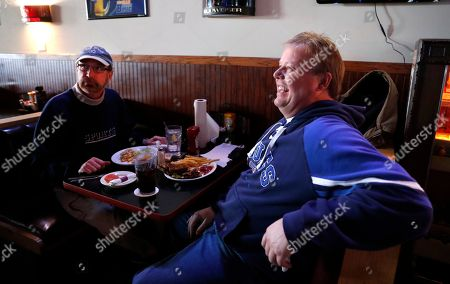 Phil Heidemann, left, and Bob Rothschild discusses whether or not they'll watch the upcoming Super Bowl while having lunch at a sports bar in Fenton, Mo. St. Louisans may watch the game this weekend but few will be rooting for the Rams, the team that left the city for Los Angeles three years ago, leaving hard feelings and Rams owner Stan Kroenke and his team being even less popular than the Cubs