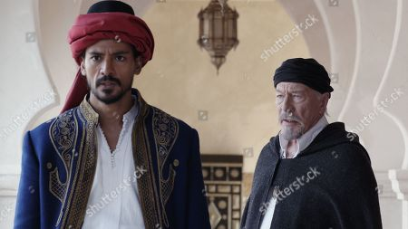 Stock Image of Jan Uddin as Tariq and Christopher Plummer as Thanasi
