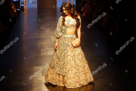 Stock Picture of Indian film actress Mouni Roy displays a creation by Payal Singhal during the Lakme Fashion Week in Mumbai, India