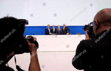 Board member Oliver Burkhard, new ThyssenKrupp CFO Johannes Dietsch, ThyssenKrupp CEO Guido Kerkhoff and board member Donatus Kaufmann poses for photographers during the company's annual general meeting in Bochum, Germany, 01 February 2019. ThyssenKrupp, that is going through a major restructuring process, confirmed their outlook for 2018-2019. The company expects to have an adjusted operating profit of more than one billion euro from its continuing operations.