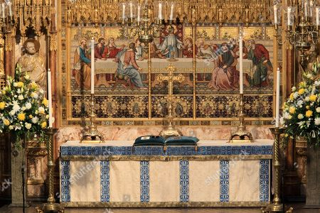 The Lord Carrington's orders and decorations laid on the High Altar.