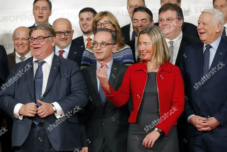 Serbian Foreign Minister Invica Dacic (not pictured) is invited by European Union Foreign Policy Chief Federica Mogherini (C-R) as Finland's Timo Soinini (L), Germany's Heiko Maas (C-L) and Romania's Teodor Melescanu (R) are smiling while attending the family photo with other delegates and EU candidate countries during the second day of the Informal meeting of EU Foreign Ministers at the Romanian National Bank Headquarters in Bucharest, Romania, 01 February 2019.