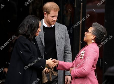 Meghan Duchess of Sussex shakes hands with Lord-Lieutenant of Bristol Peaches Golding as Prince Harry looks on as they leave after a visit to the Old Vic Theatre in Bristol, England
