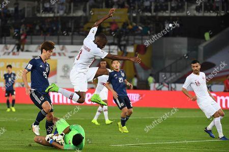 Japan's forward Yuya Osako, left, challenges Qatar's goalkeeper Saad Al Sheeb, down, and Qatar's defender Abdelkarim Hassan, right, during the AFC Asian Cup final match between Japan and Qatar in Zayed Sport City in Abu Dhabi, United Arab Emirates