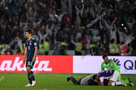 Japan's forward Yuya Osako, left, walks on the pitch after loosing the AFC Asian Cup final match between Japan and Qatar in Zayed Sport City in Abu Dhabi, United Arab Emirates