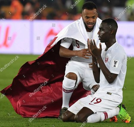 Qatar's forward Almoez Ali, right, celebrates with Qatar's midfielder Ahmed Fathi, left, after winning the AFC Asian Cup final match between Japan and Qatar in Zayed Sport City in Abu Dhabi, United Arab Emirates