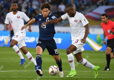 Japan's forward Yuya Osako, left, challenges Qatar's defender Abdelkarim Hassan, right, during the AFC Asian Cup final match between Japan and Qatar in Zayed Sport City in Abu Dhabi, United Arab Emirates