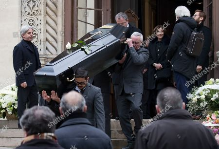 Macha Meril (2-R), widow of the late French composer Michel Legrand, looks on as the coffin of her husband is carried into the Saint-Alexandre-Nevsky Orthodox church for Legrand's funeral, in Paris, France, 01 February 2019. Oscar-winning Legrand, who composed music scores for classic films such as 'The Umbrellas of Cherbourg', died aged 86 on 26 January 2019.