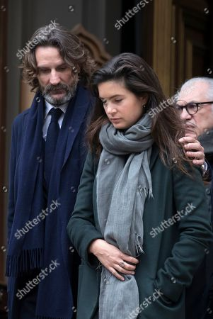 Frederic Beigbeder (L) and his wife Lara Micheli attend the funeral of the late French composer Michel Legrand at the Saint-Alexandre-Nevsky Orthodox church in Paris, France, 01 February 2019. Oscar-winning Legrand, who composed music scores for classic films such as 'The Umbrellas of Cherbourg', died aged 86 on 26 January 2019.