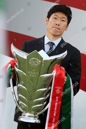 Stock Image of South Korean soccer player Park-Ji sung presents the trophy prior the 2019 AFC Asian Cup final match between Japan and Qatar in Abu Dhabi, United Arab Emirates, 01 February 2019.