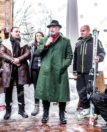 Arnold Schwarzenegger (C), Austrian-US actor and former California governor, speaks next to Head CEO Johan Eliasch (R) during the presentation of skis branded for his 'R20 Austrian World Summit' climate initiative  at the Rasmushof Alm in Kitzbuehel, Austria, 26 January 2019.