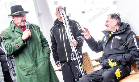 (L-R) Arnold Schwarzenegger, Austrian-US actor and former California governor, speaks next to Head CEO Johan Eliasch, and Austrian former alpine ski champion Franz Klammer during the presentation of skis branded for his 'R20 Austrian World Summit' climate initiative  at the Rasmushof Alm in Kitzbuehel, Austria, 26 January 2019.