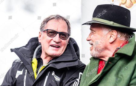 Arnold Schwarzenegger (R), Austrian-US actor and former California governor, speaks next  Austrian former alpine ski champion Franz Klammer (L) during the presentation of skis branded for his 'R20 Austrian World Summit' climate initiative  at the Rasmushof Alm in Kitzbuehel, Austria, 26 January 2019.