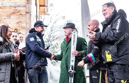 (L-R) Norwegian skier Aksel Lund Svindal, Austrian-US actor and former California governor Arnold Schwarzenegger, Head CEO Johan Eliasch and former alpin ski champion Franz Klammer during the presentation of skis branded for Schwarzenegger's 'R20 Austrian World Summit' climate initiative  at the Rasmushof Alm in Kitzbuehel, Austria, 26 January 2019.