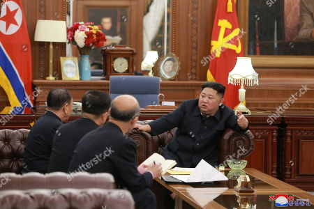 A photo released by the official North Korean Central News Agency (KCNA) show Kim Jong Un (R), Chairman of the Workers' Party of Korea, chairman of the State Affairs Commission of the DPRK and supreme commander of the Korean People's Army, as he met with the delegation to the second DPRK-US high-level talks that had visited Washington D.C. of the United States, in Pyongyang, North Korea, 23 January 2019. Kim Jong Un met the members of the delegation led by Vice-Chairman Kim Yong Chol and listened to the results of the visit.