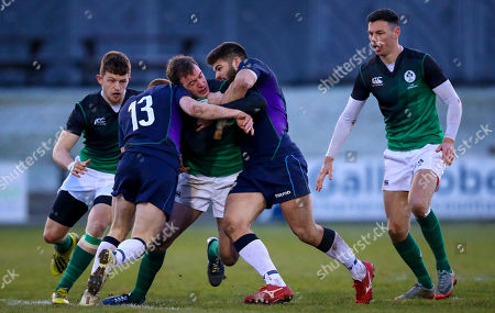 Stock Picture of Scotland Clubs vs Ireland Club XV. Ireland's Niall Kenneally with Robbie Kay and Robbie Nelson of Scotland
