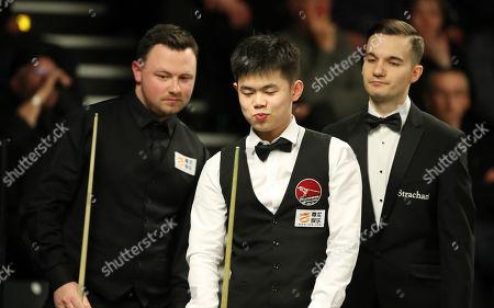 Stock Picture of Duane Jones, Yuan SiJun, referee Marcel Eckardt