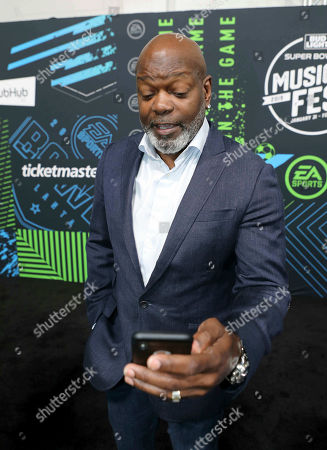 Emmitt Smith arrives during the Bud Light Super Bowl Music Fest EA SPORTS BOWL at State Farm Arena, in Atlanta