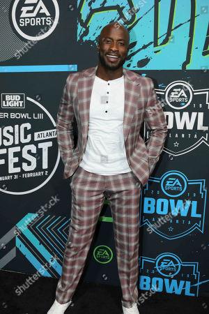 Akbar Gbajabiamila arrives during the Bud Light Super Bowl Music Fest EA SPORTS BOWL at State Farm Arena, in Atlanta